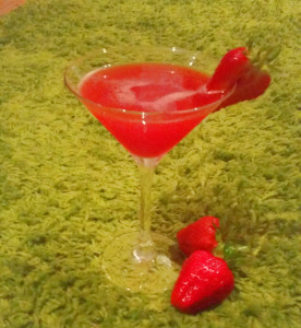 Strawberry Daiquiri in martini glass with strawberry garnish